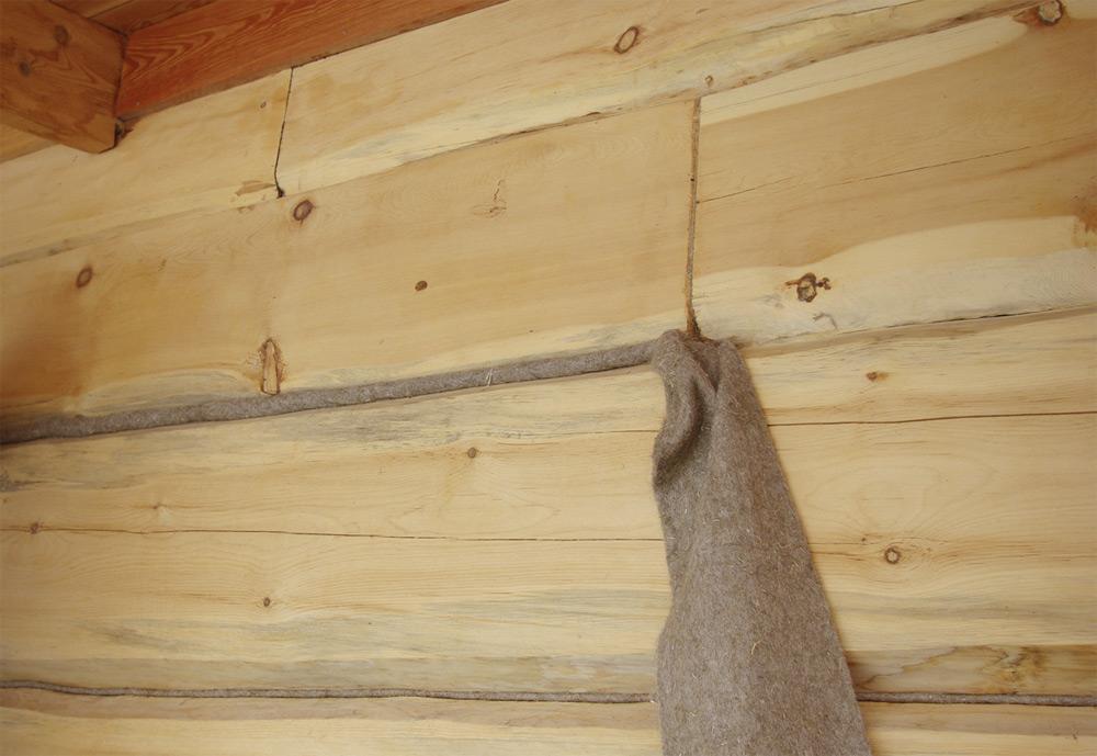 Фото: конопатка дома из бруса цена