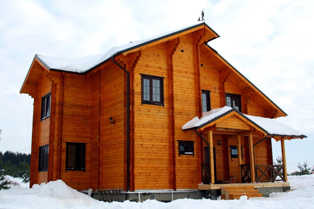 фото: внешний вид дома из двойного бруса