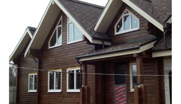 фото: покраска дома из клееного бруса