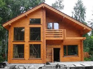 фото: покраска дома из профилированного бруса