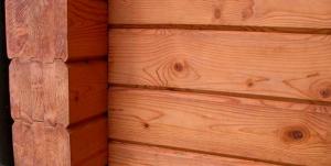 фото: пропитка дома из клееного бруса