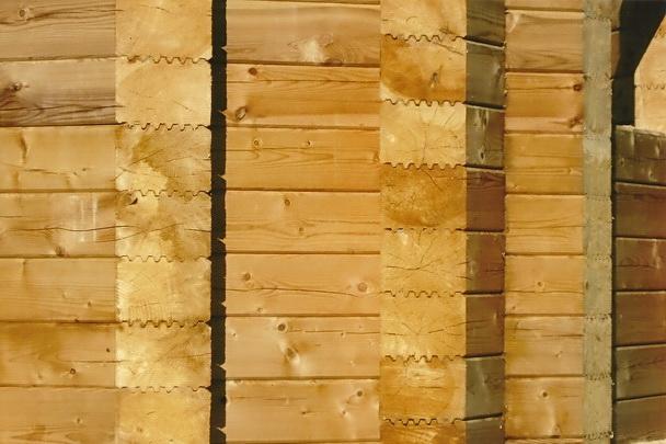 фото: Обработка дома из профилированного бруса