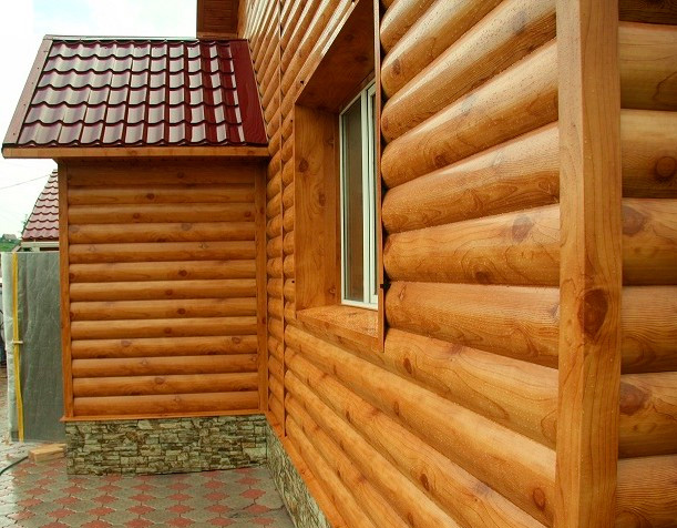 фото: внешняя отделка дома из бруса