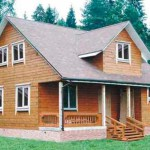фото: дом по типовому проекту с монсардой